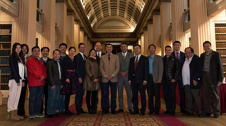 Iain Nicol (7th from right) and colleagues, Solicitor Andrew Wallace (8th left) and Partner Robert Holland (10th left) with the delegation from China at the Playfair Library after the presentation