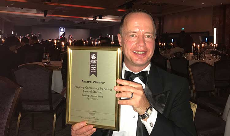 Mark Coulter collecting the Property Consultancy Marketing Award at the Property Awards